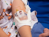 330L I.V. House UltraDressing on child's elbow
