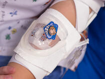 730Arm I.V. House UltraDressing on child's elbow