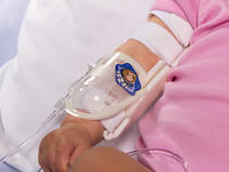 750LFP I.V. House UltraDome Plus on infant's elbow