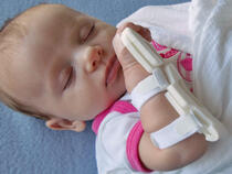 939S-Ultra TLC Wrist Splint on sleeping infant's wrist