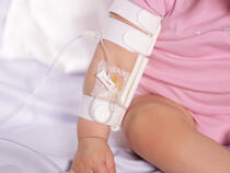 959S-Ultra TLC Elbow Splint and 330L I.V. House UltraDressing on infant